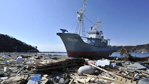 Whaling ship taisho maru no 28 amongst beached debris following Japan's 2011 earthquake and tsunami